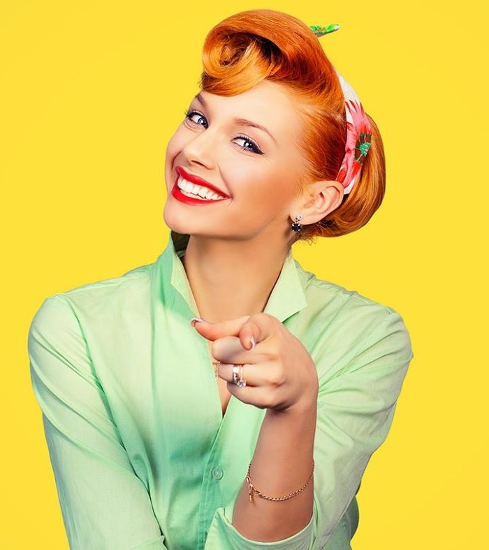 woman with red hair 1950s hairstyle most iconic looks wearing green shirt