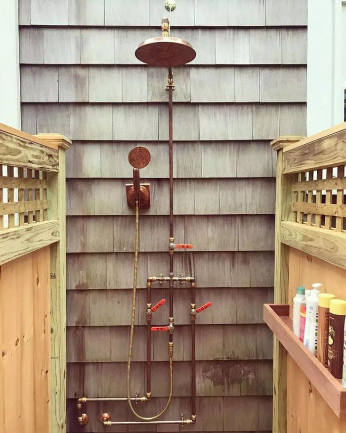 wood wall and enclosures with shelves outdoor shower ideas brass pipes and shower head industrial style