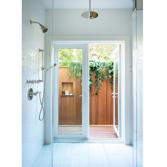 wood wall with plants and built in shelf building an outdoor shower with tiled floor and wall