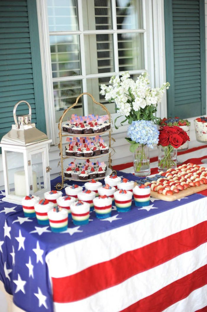 american flag table cloth on desserts table 4th of july wreath cupcakes mousse flowers on the table