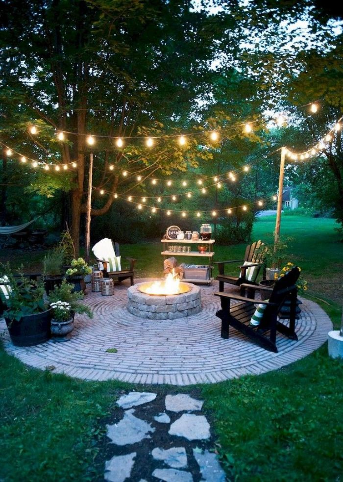 bar cart four lounge chairs arranged around round outdoor fire pit ideas made of stones