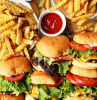 best burger recipe lots of burgers arranged on platter with french fries ketchup