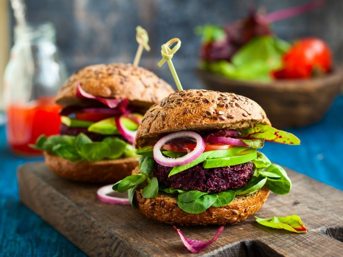 best hamburger recipe two vegan burgers with beets and quinoa tomatoes peppers spinach onions