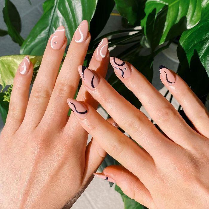 black and white lines on nude nail polish cute nail designs medium length almond nails