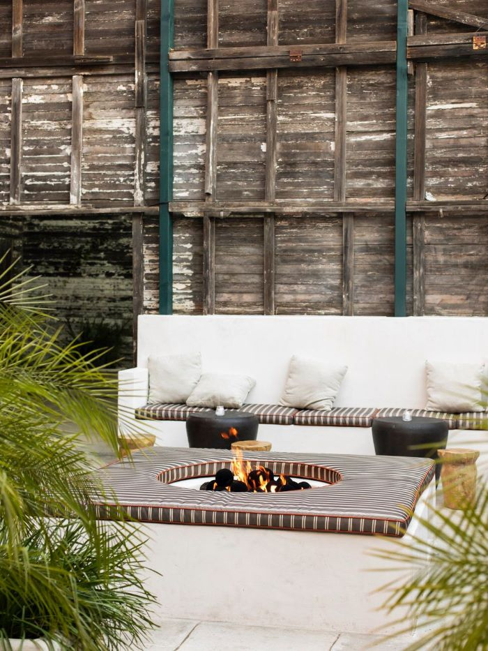 black leather ottomans white bench next to round fire pit how to make a fire pit cushion around it