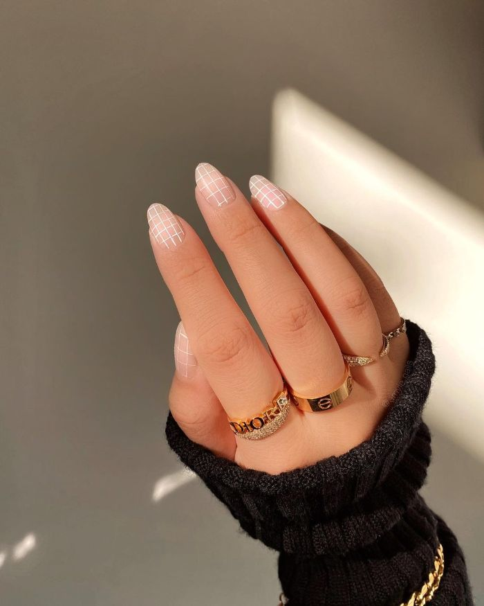 black sweater with gold jewelry nail designs 2021 nude nail polish with white lines decorations