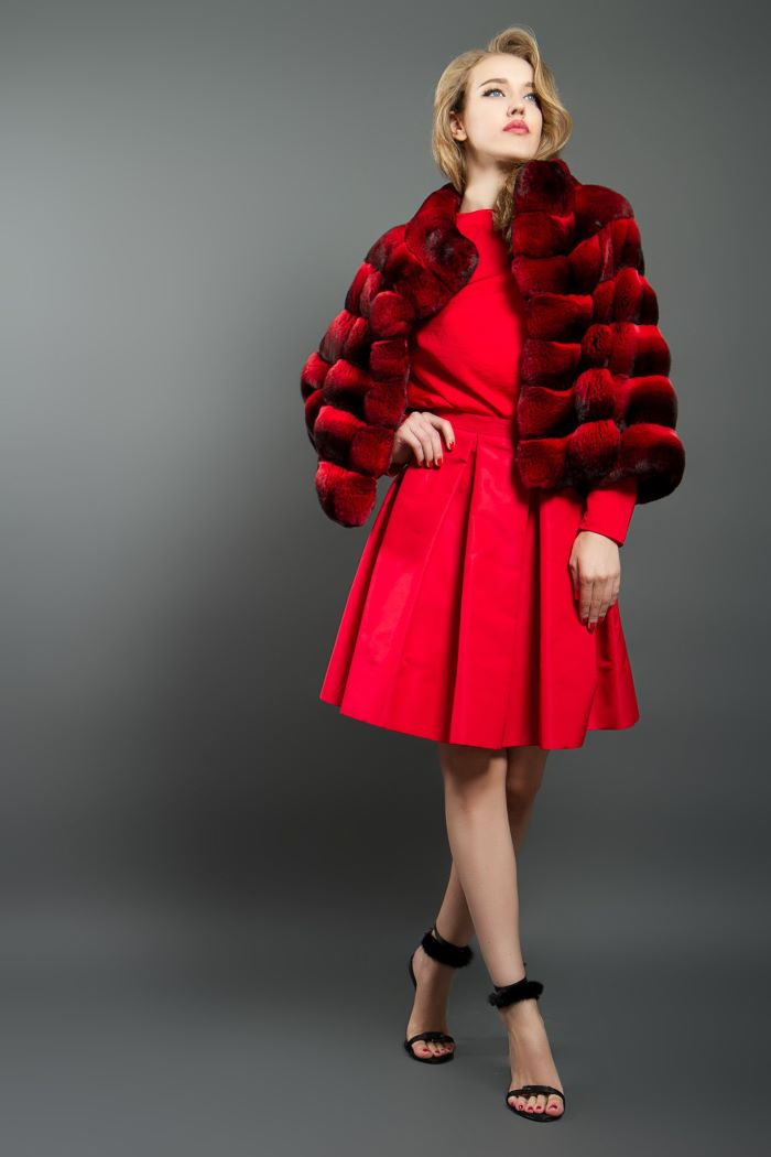 blonde woman wearing red skirt and blouse black sandals women fashion for summer 2021 red chinchilla jacket