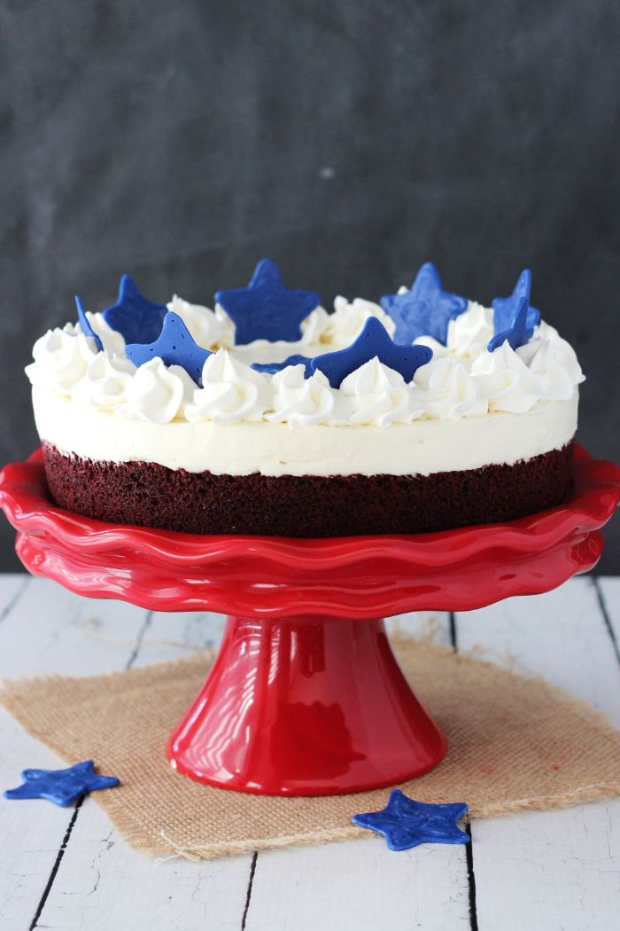 blondie cheesecake placed on red cake stand 4th of july desserts decorated with blue stars