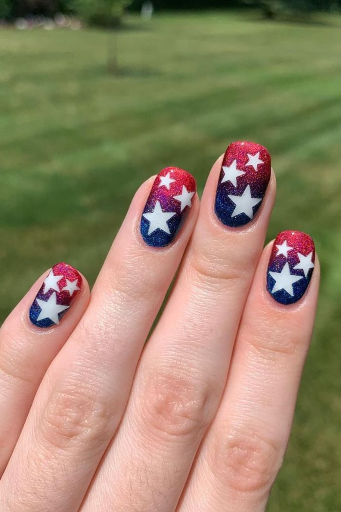 blue and red glitter ombre nail polish 4th of july nails white stars drawn on nails