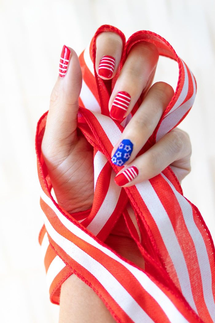 blue and red nail polish on medium length squoval nails 4th of july nail designs stripes and stars decorations