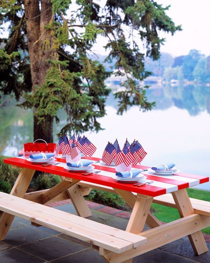 blue napkins on red and white striped table 4th of july wreath decorated with american flags