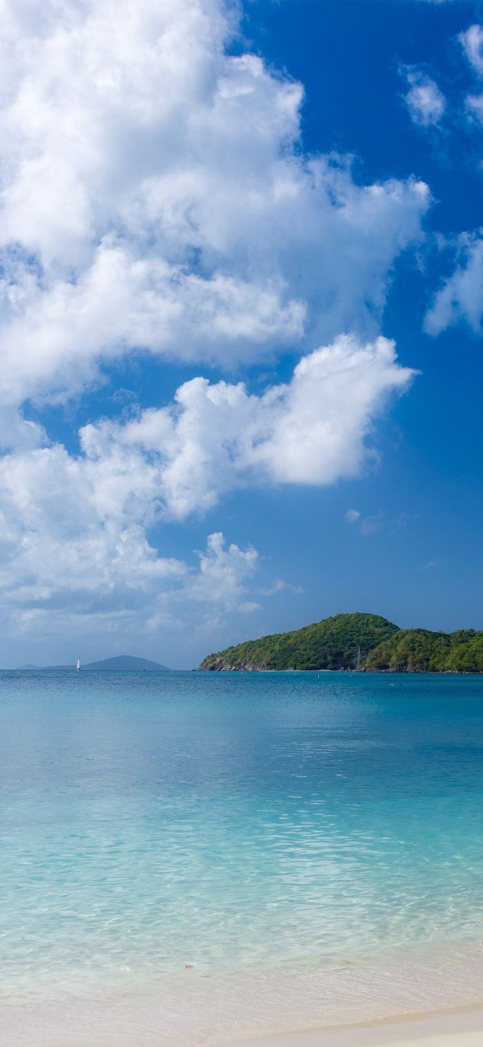 blue water and sky with clouds summer wallpaper hd island in the distance
