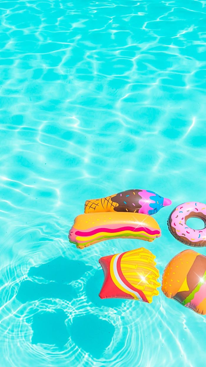 blue water in swimming pool summer cute backgrounds inflated pillows donut fries milkshake hot dog sandwich