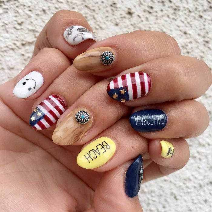 blue white red yellow beige nail polish red white and blue nails different decoration on each almond shaped nail