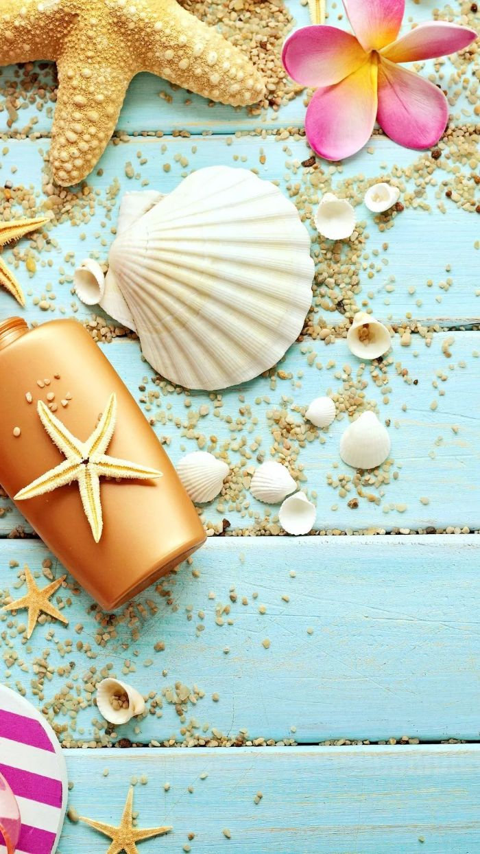 blue wooden surface summer wallpaper hd seashells and sunscreen beach sand on it