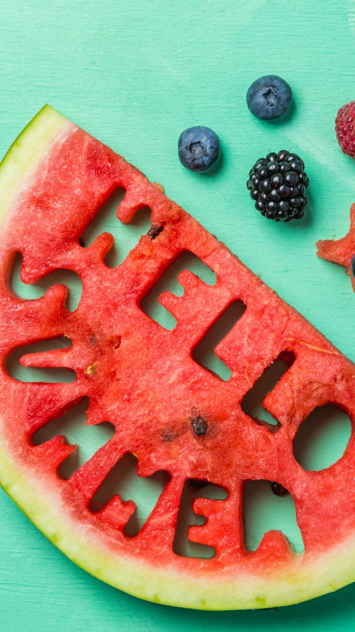 blueberries blackberries next to slice of watermelon beach aesthetic wallpaper hello summer carved on it