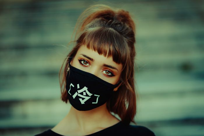 brunette woman with bangs hairs in half ponytail women fashion for summer 2021 wearing black face mask