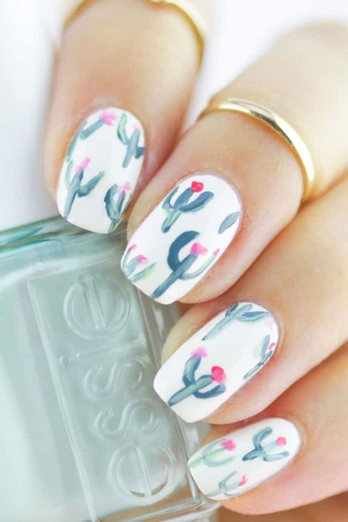 cactuses decorations painted with green on white nail polish summer nail designs medium length squoval nails