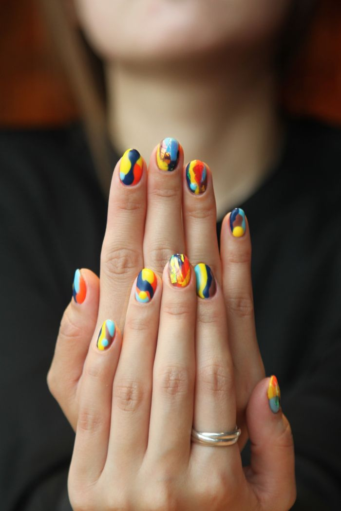 colorful abstract nails cute nail designs made with blue yellow red orange brown nail polish