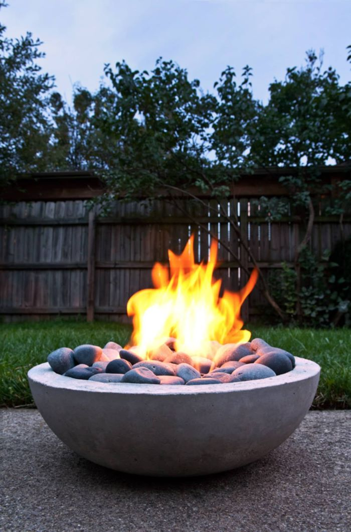 concrete bowl filled with rocks fire burning inside fire pit seating ideas step by step diy tutorial