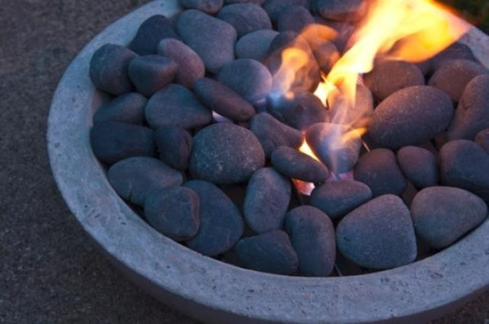 concrete bowl filled with rocks step by step diy tutorial backyard fire pit ideas landscaping fire burning inside