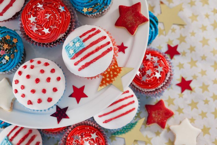 cupcakes decorated with different frosting in red white blue fourth of july recipes star sprinkles on top