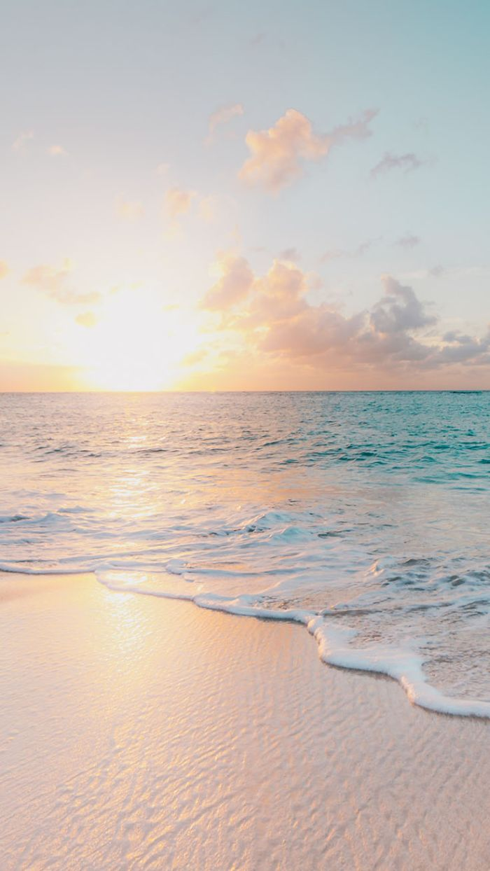 cute summer backgrounds waves crashing into the beach photographed at sunset