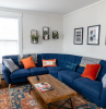 décor ideas for living room large blue corner sofa orange throw pillows art work on the walls