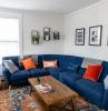 décor ideas for living room large blue corner sofa orange throw pillows art work on the walls