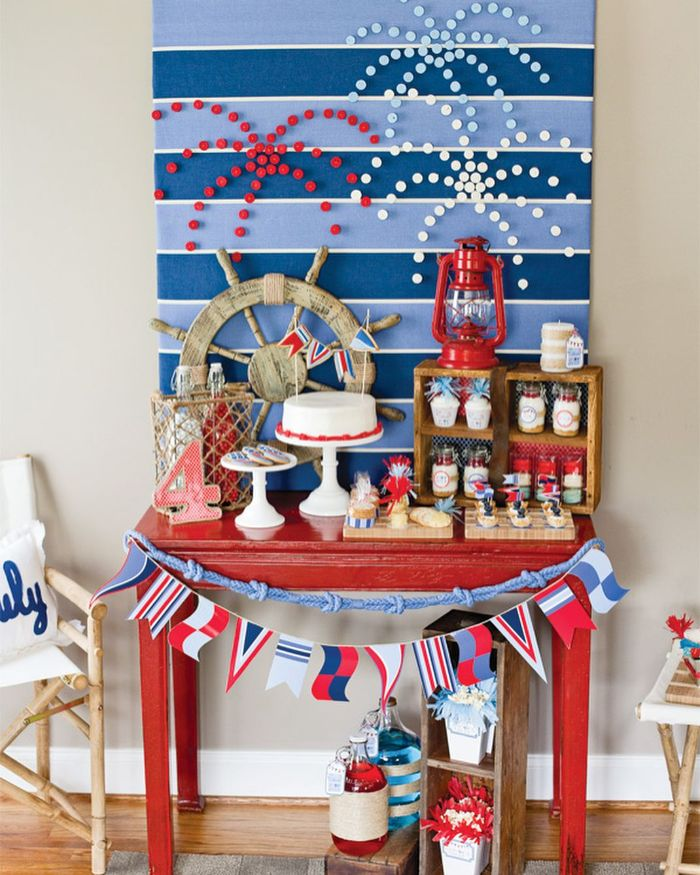 desserts table painted in red with cake cupcakes on it patriotic decorations fireworks background
