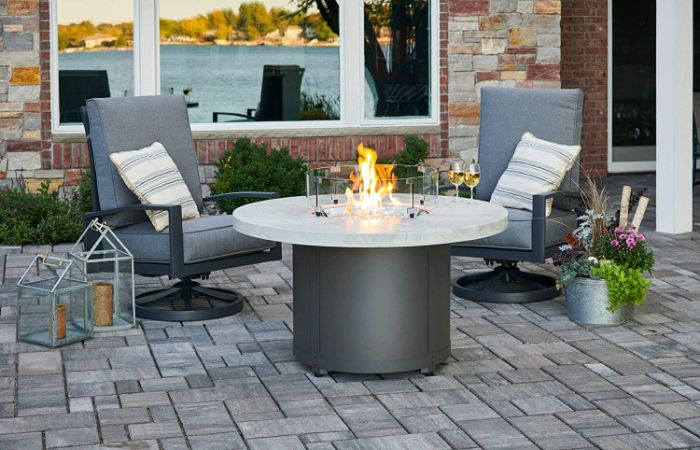 diy fire pit ideas two lounge chairs with gray cushions next to round fire pit two wine glasses on top