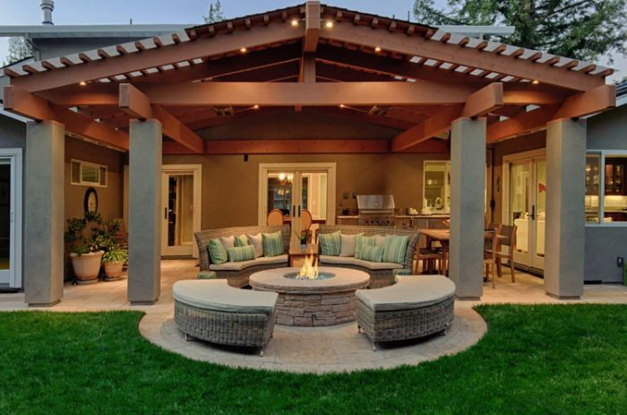 enclosed lounge area with blue throw pillows backyard fire pit ideas rattan furniture