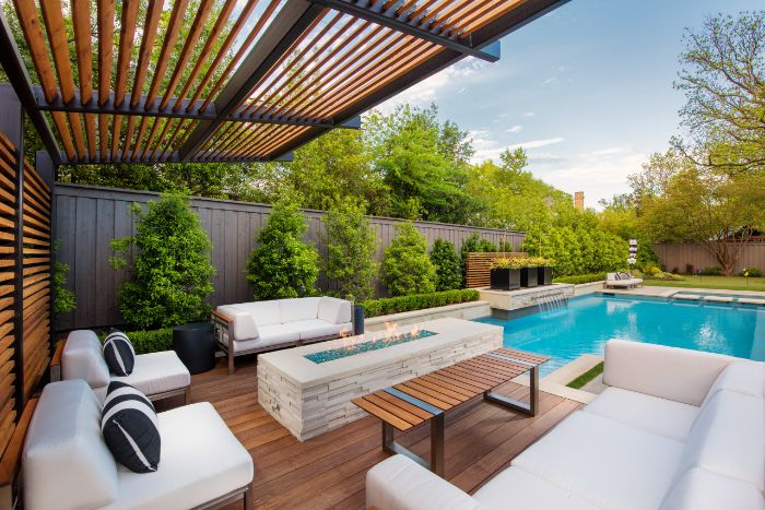 fire pit seating ideas concrete fire pit next to swimming pool garden furniture under pergola
