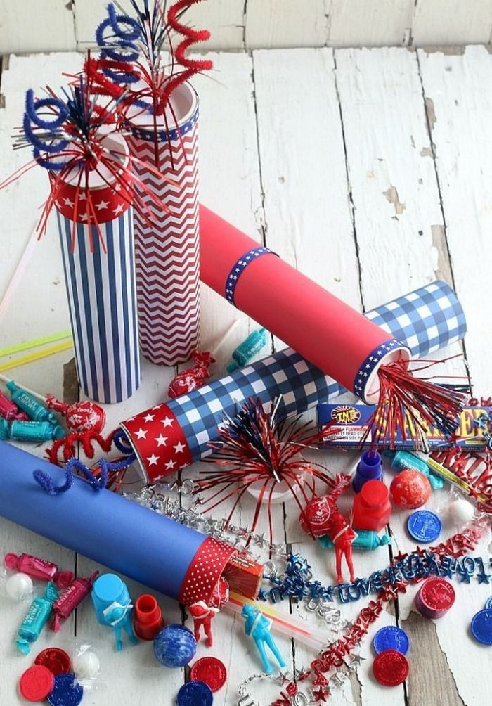 firecrackers in red white and blue placed on white wooden surface 4th of july wreath