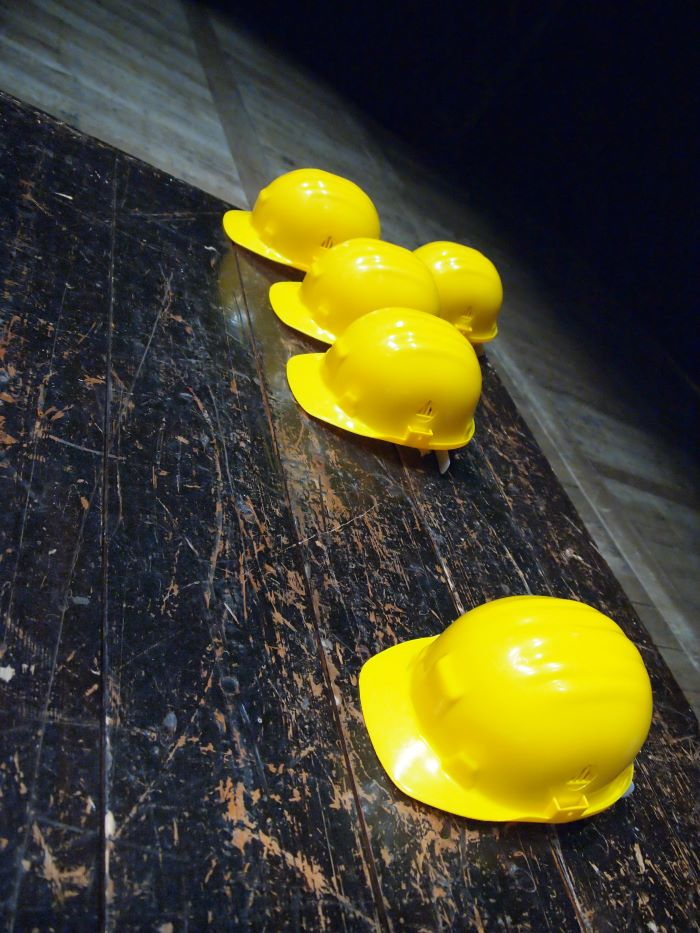 five yellow safety hats placed on dark wooden floor construction business ideas