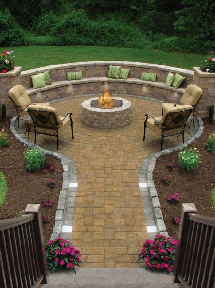 four lounge chairs bench homemade fire pit round made of stones pathway leading to it