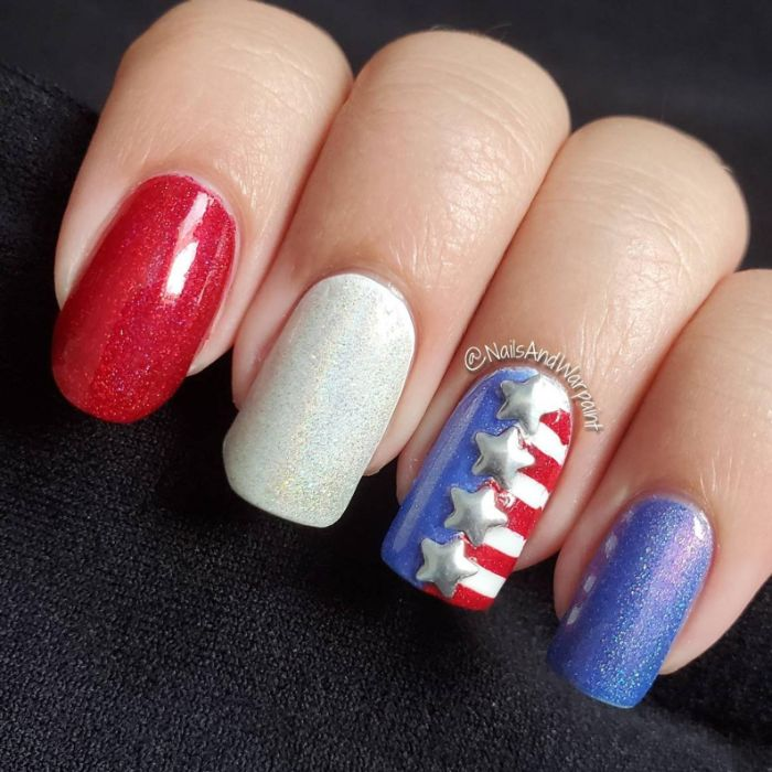fourth of july nails red white blue glitter nail polish stars and stripes on the ring finger