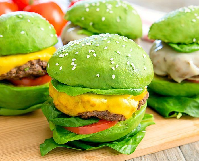 green avocado buns with sesame seeds best burger recipe vegan burger placed on wooden cutting board