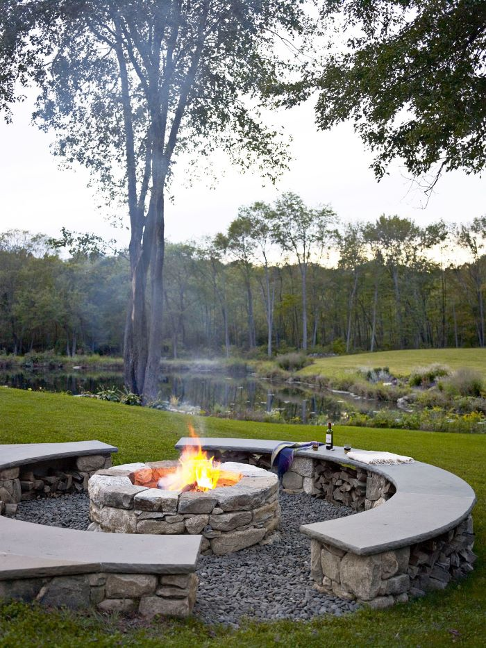 half moon benches made of stones next to diy fire pit ideas made of stones