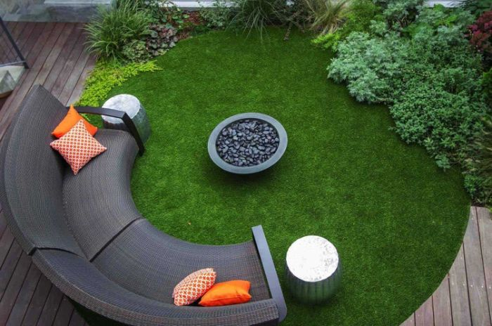 half moon sofa with orange throw pillows outdoor fire pit ideas concrete bowl filled with rocks