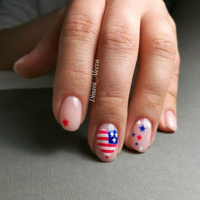 heart shaped american flag on the middle finger 4th of july nail designs red white and blue stars