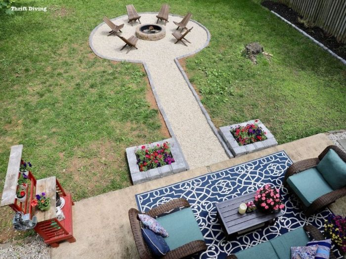 homemade fire pit seating area with wooden lounge chairs arranged around round fire pit made of stones