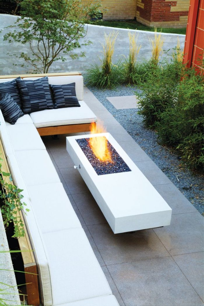 how to make a fire pit wooden bench with white cushions blue throw pillows concrete fire pit with rocks