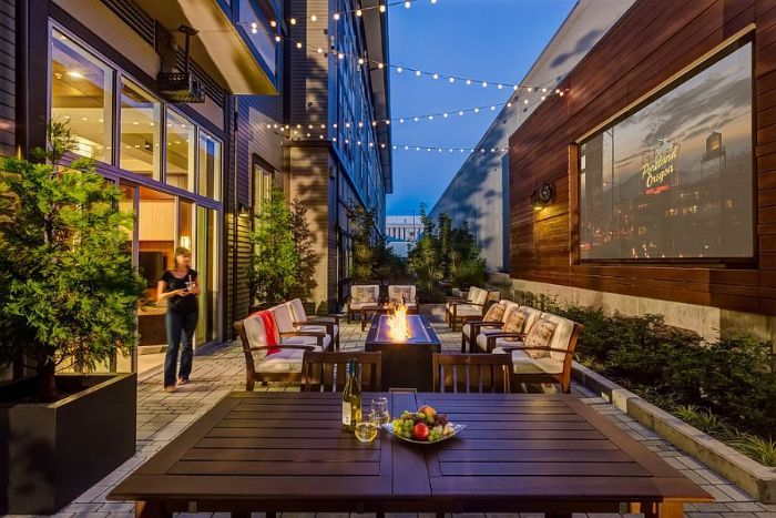 large backyard with strings of lights how to build a fire pit garden furniture arranged around fire pit