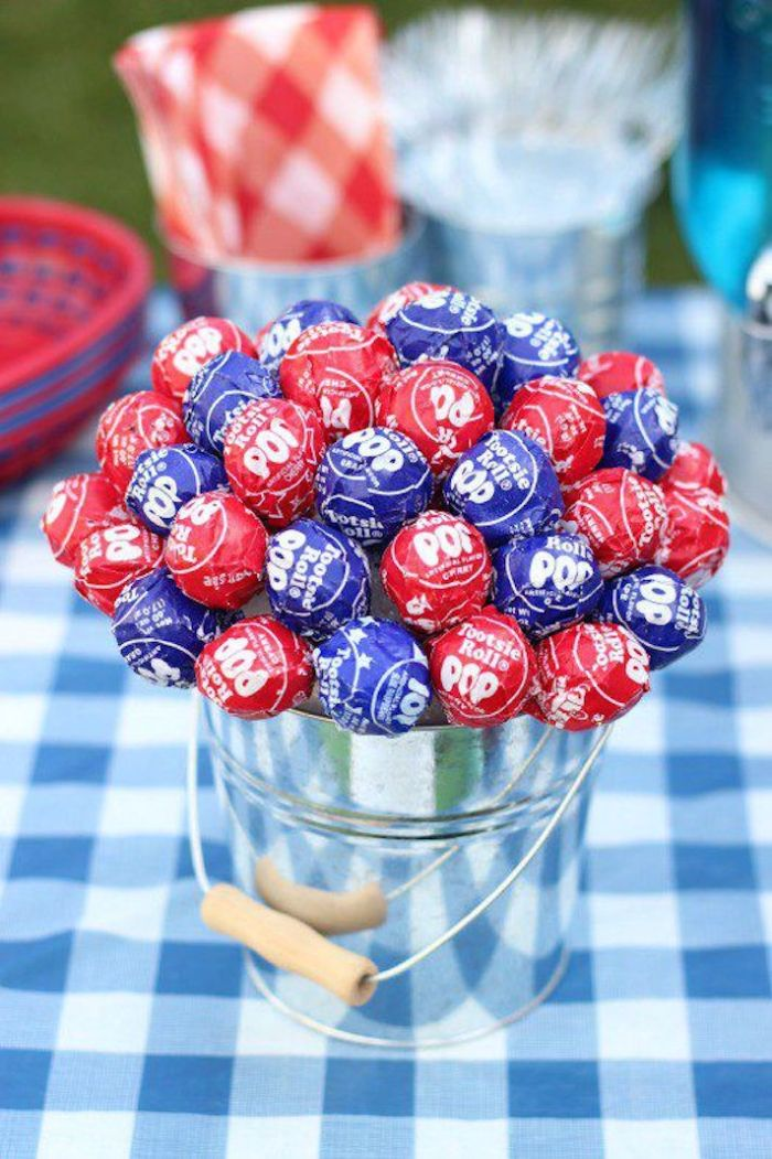 lollipops in blue and red arranged as bouquet inside bucket fourth of july crafts table centerpiece