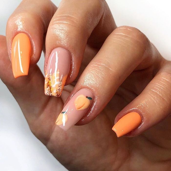 long coffin nails with orange nail polish summer nail designs peaches decorations on ring finger
