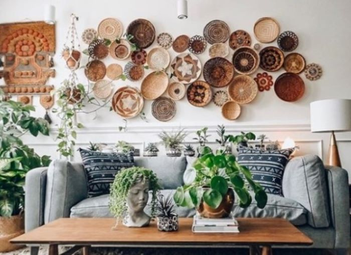 lots of baskets arranged on white wall with different patterns décor ideas for living room above gray sofa