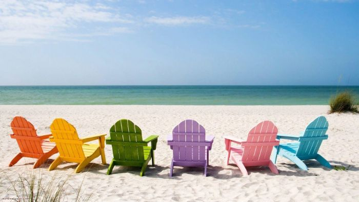 lounge chairs in orange yellow green purple pink blue on beach beautiful iphone wallpaper