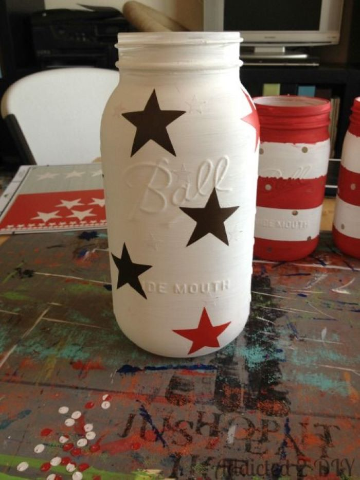 mason jar painted in white 4th of july banner step by step diy tutorial for candle holder