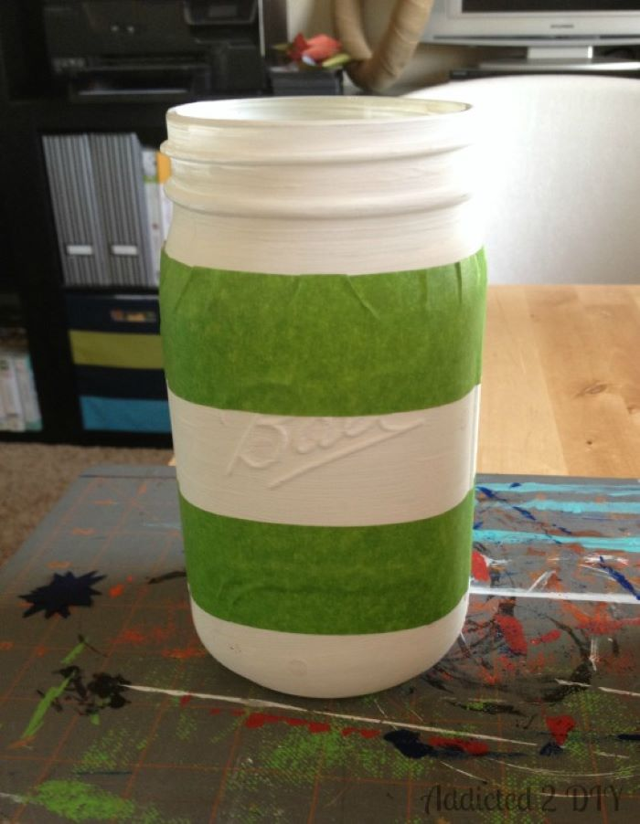 mason jar painted in white 4th of july banner tape wrapped around it step by step diy tutorial
